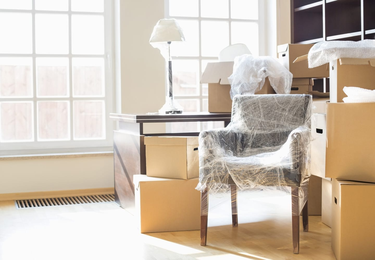 moving boxes and wrapped furniture