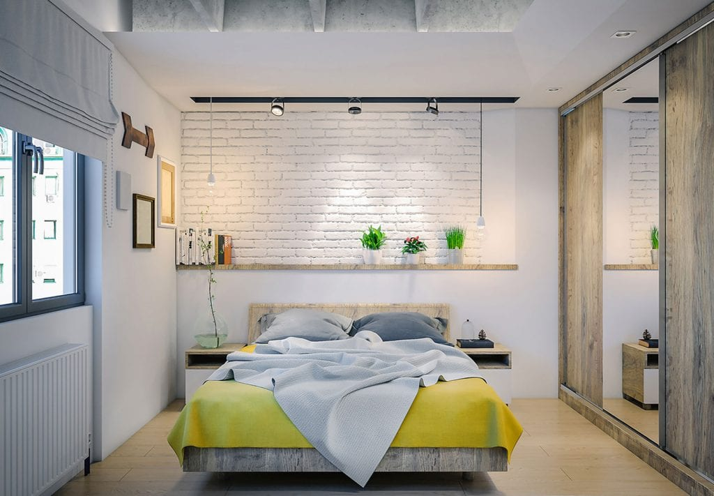 bedroom with nice furniture and light fixtures