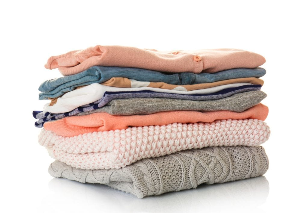 Nicely folded pink, blue, and gray clothes