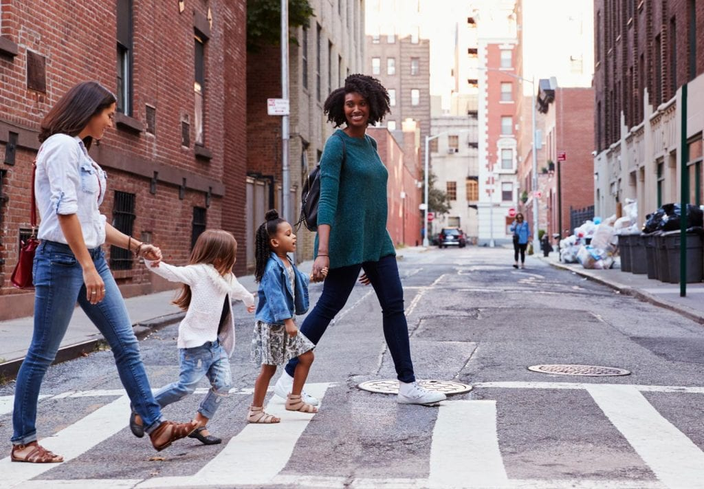NYC moms walking with their daughters