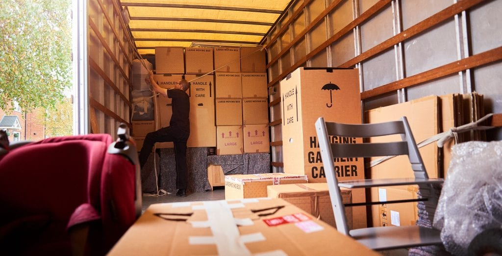 Moving truck filled with furniture and boxes