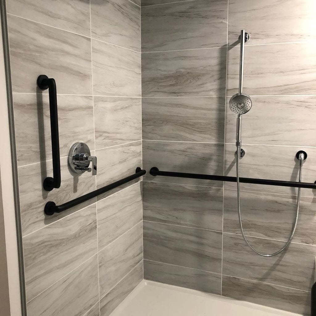 aging in place walk-in shower with handrails for safety