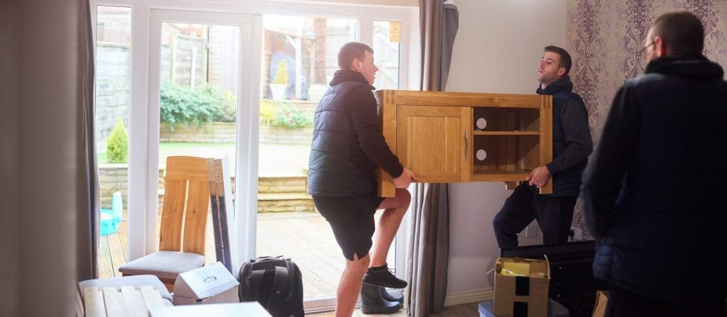 people moving furniture out of a house