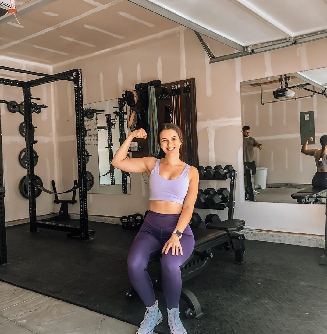 woman using her home gym garage