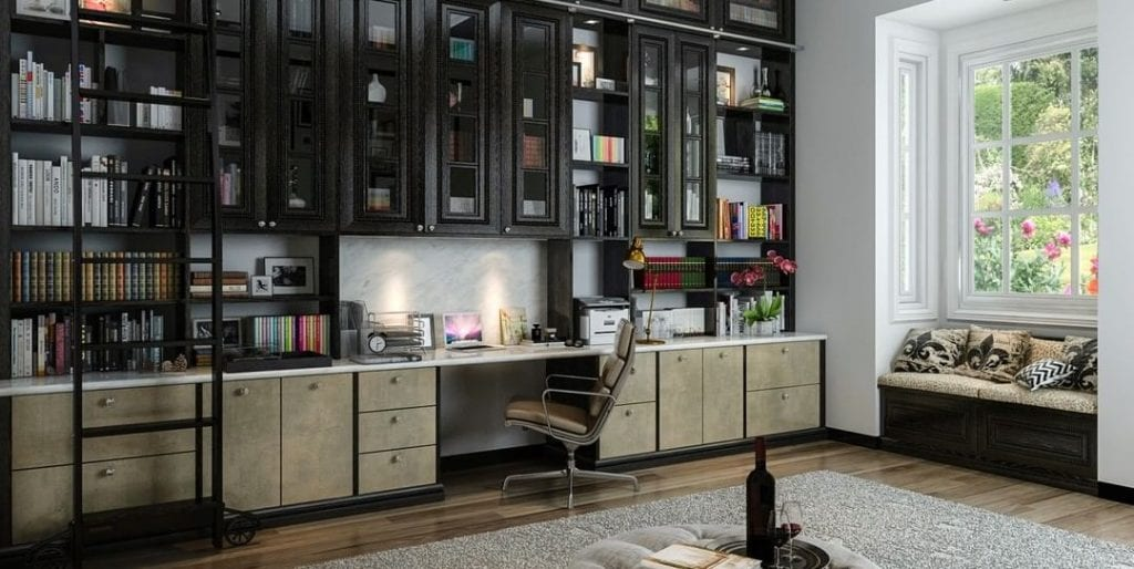Home office designed with built-in shelving and desk.
