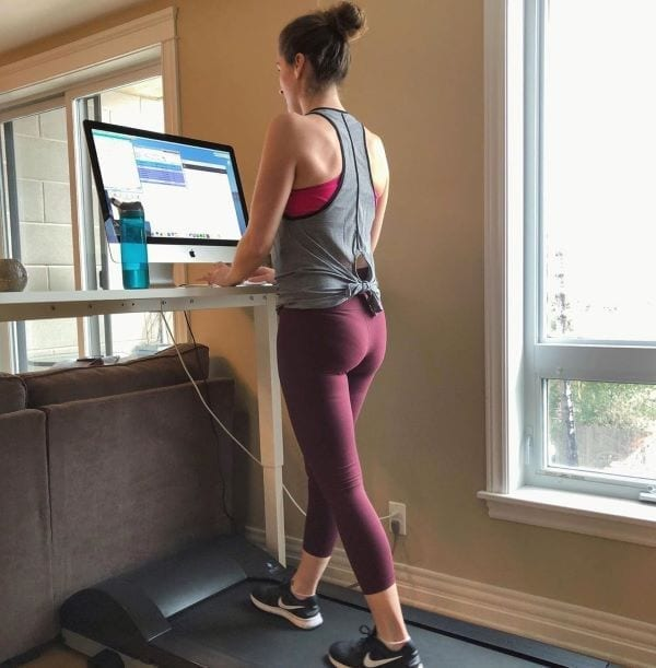 Woman working at treadmill desk