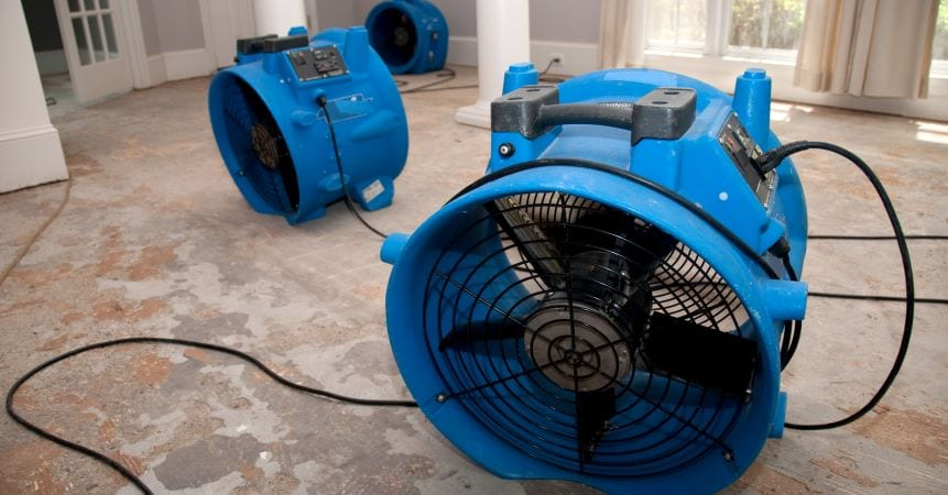 Large fans dry home after water damage