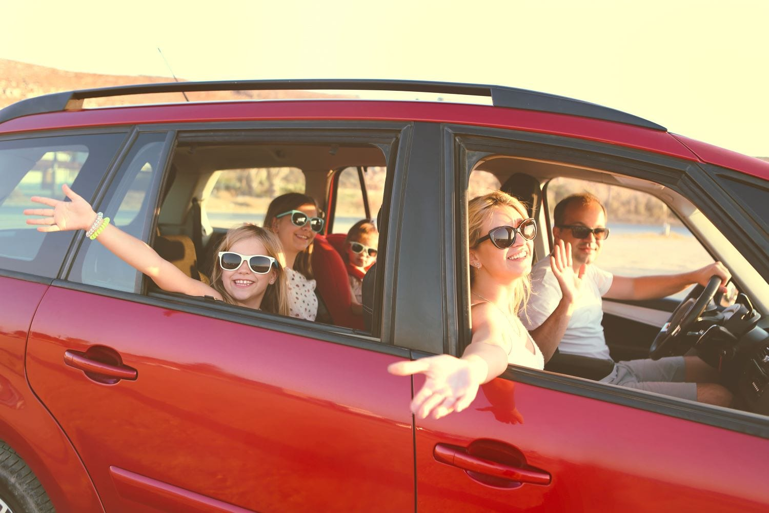 Family moving out of state in a red car
