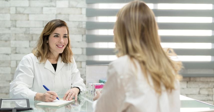 Woman doctor meets with patient