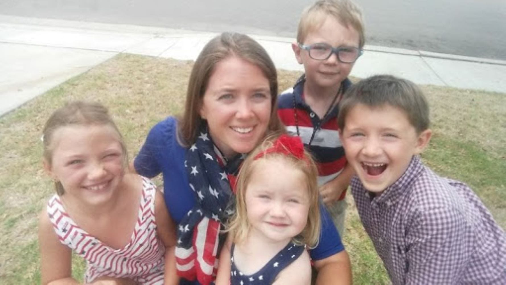 Military mom with children in patriotic clothes