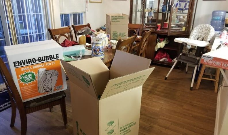 Dining room with packing boxes for moving