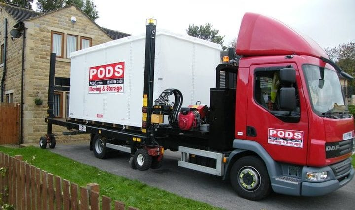 PODS portable container being unloaded from truck