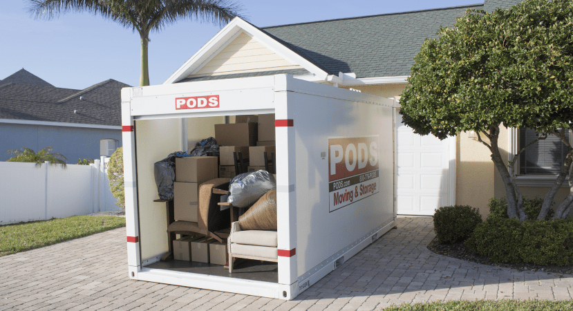 PODS Moving & Storage container packed up in the driveway.
