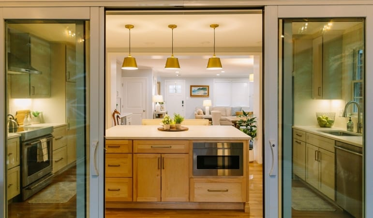sliding door entry between kitchen and covered porch addition