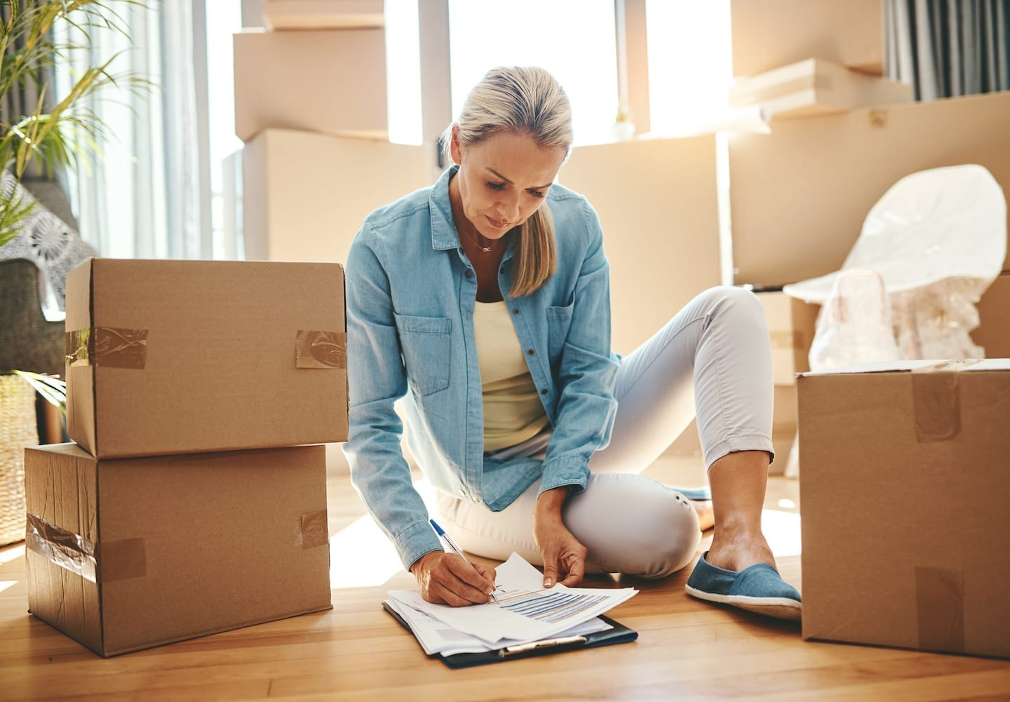woman packing with a moving checklist