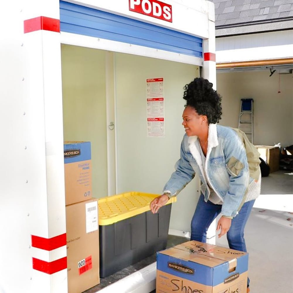 woman loading PODS moving & storage container