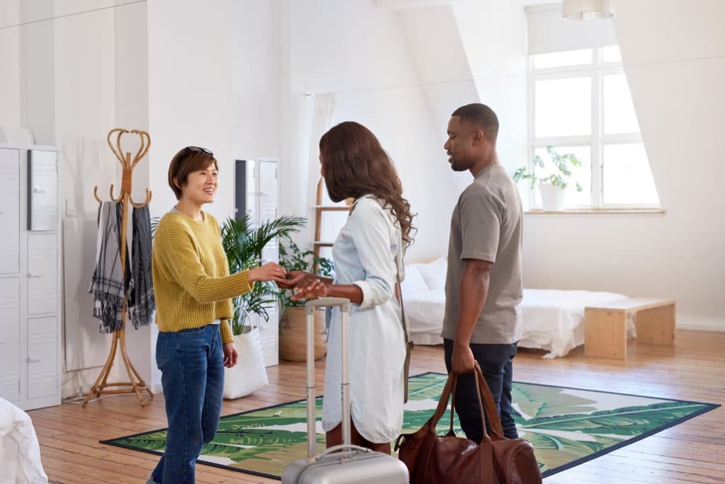 Airbnb host welcoming guests
