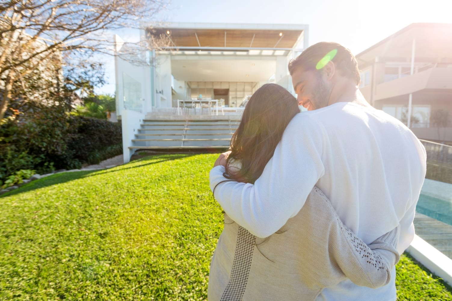 couple in front of newly built dream home