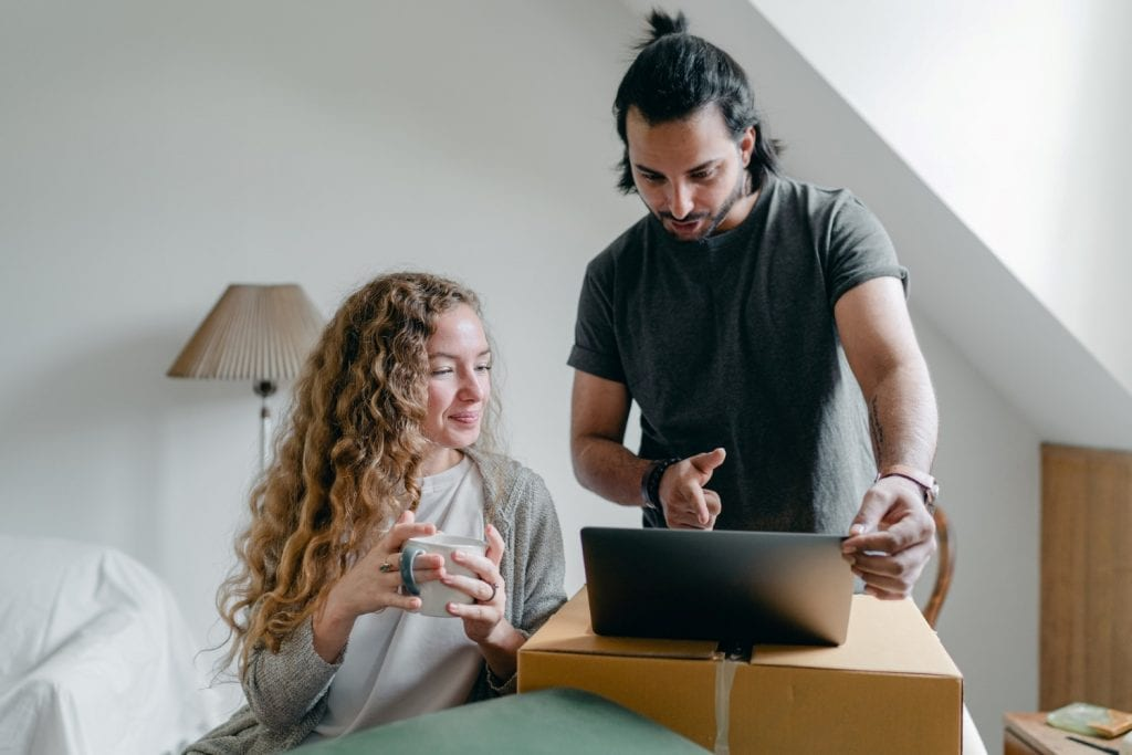 couple researching moving companies online
