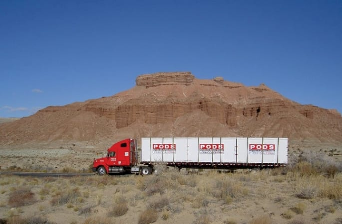 PODS truck transporting PODS portable moving containers cross-country