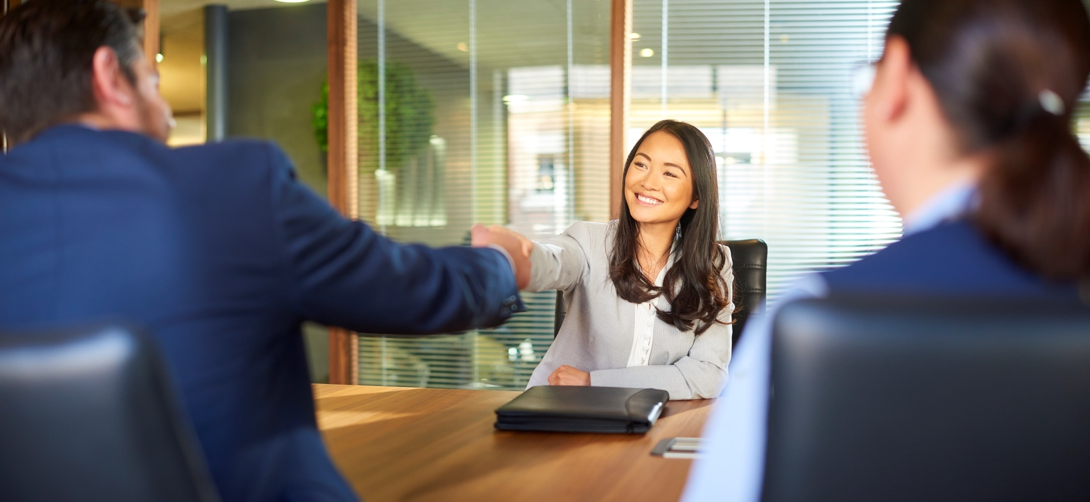woman shaking hands at a business meeting