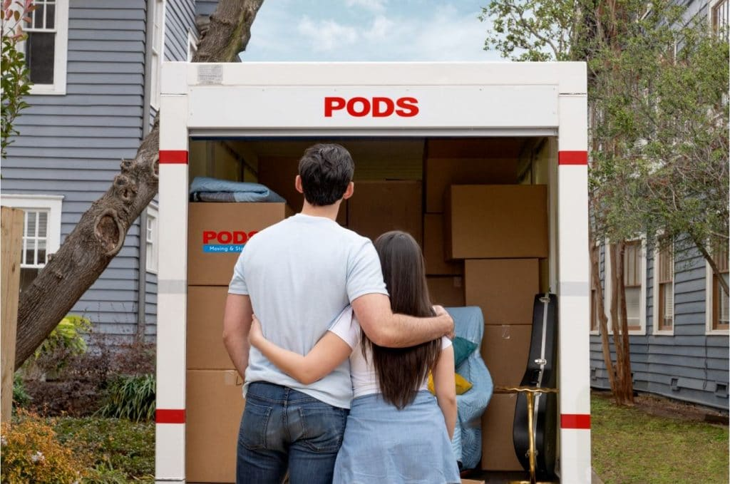 couple standing with packed PODS container