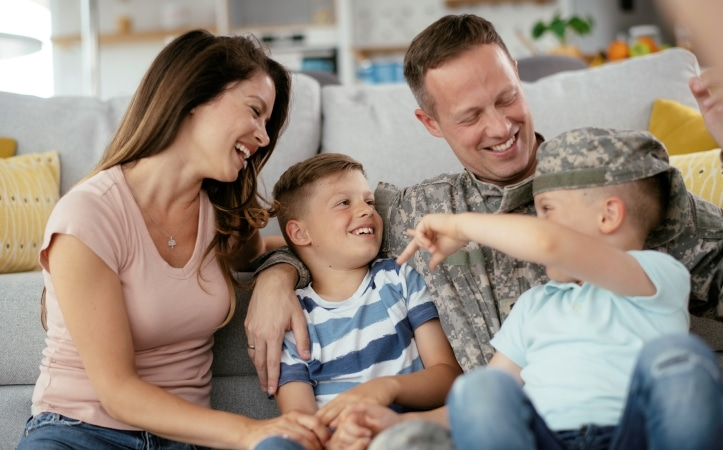 a happy military family at home