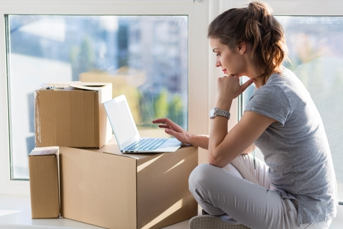 Woman researching relocation services online