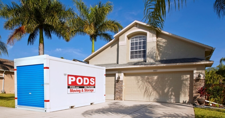 A PODS moving and storage container outside of a Florida home.