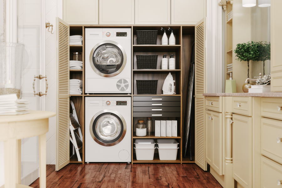Stackable washer and dryer in a laundry room