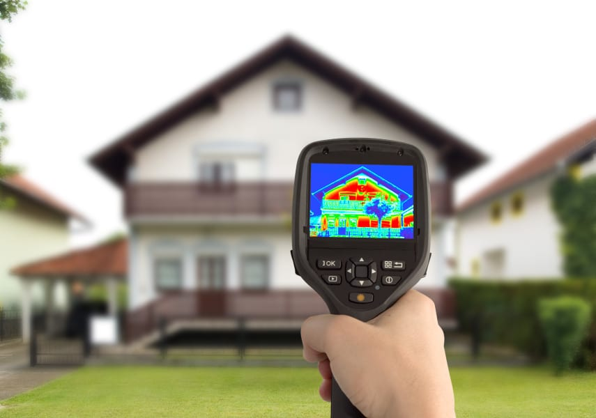 Infrared thermal camera detecting heat loss on a home