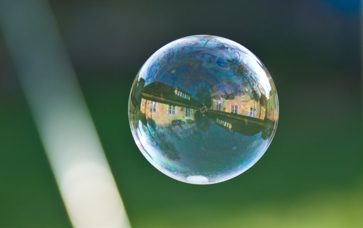 A reflection of a house inside a bubble